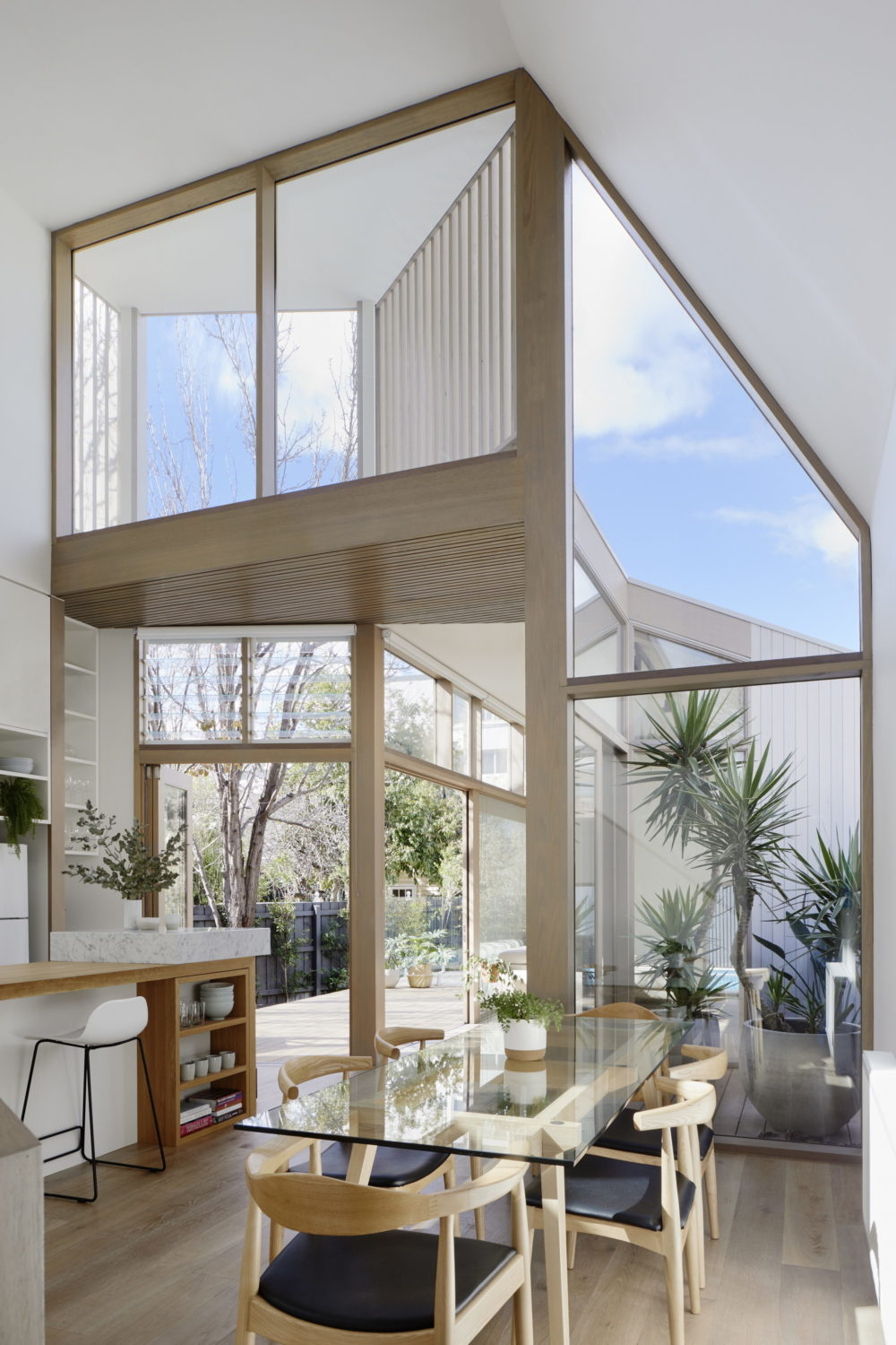 Tess + JJ's House   Narrow House by po-co Architecture