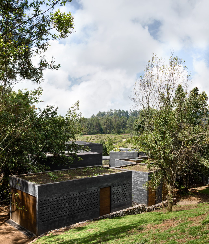 Casa Bruma | Nine Black Concrete Boxes