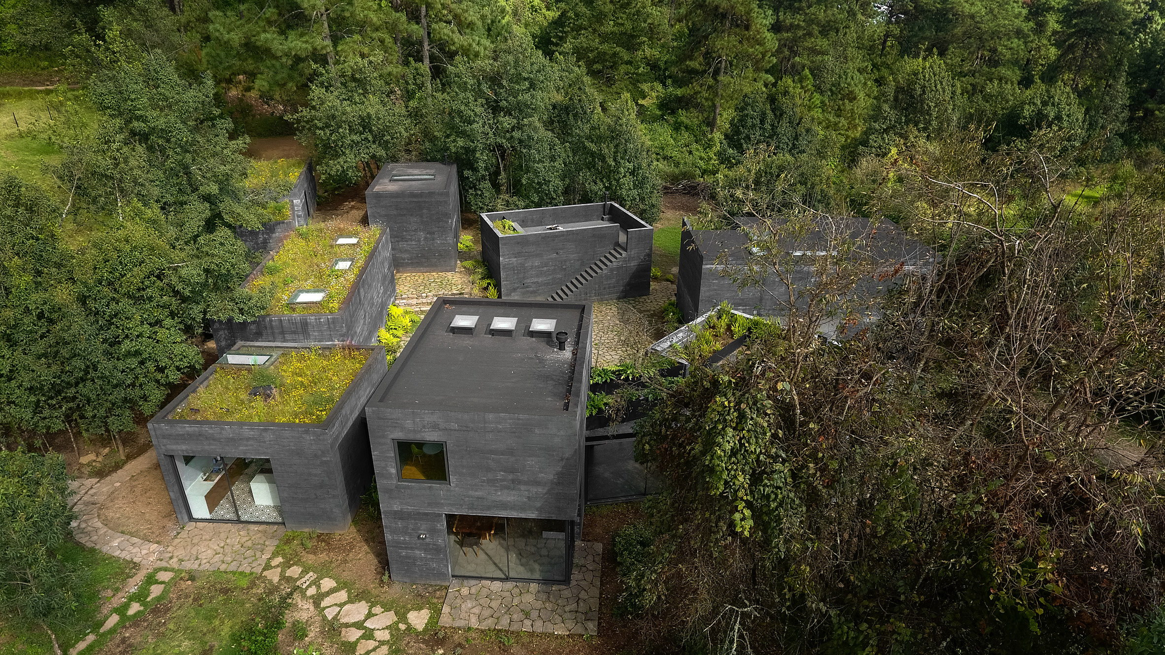 Casa Bruma | Nine Black Concrete Boxes
