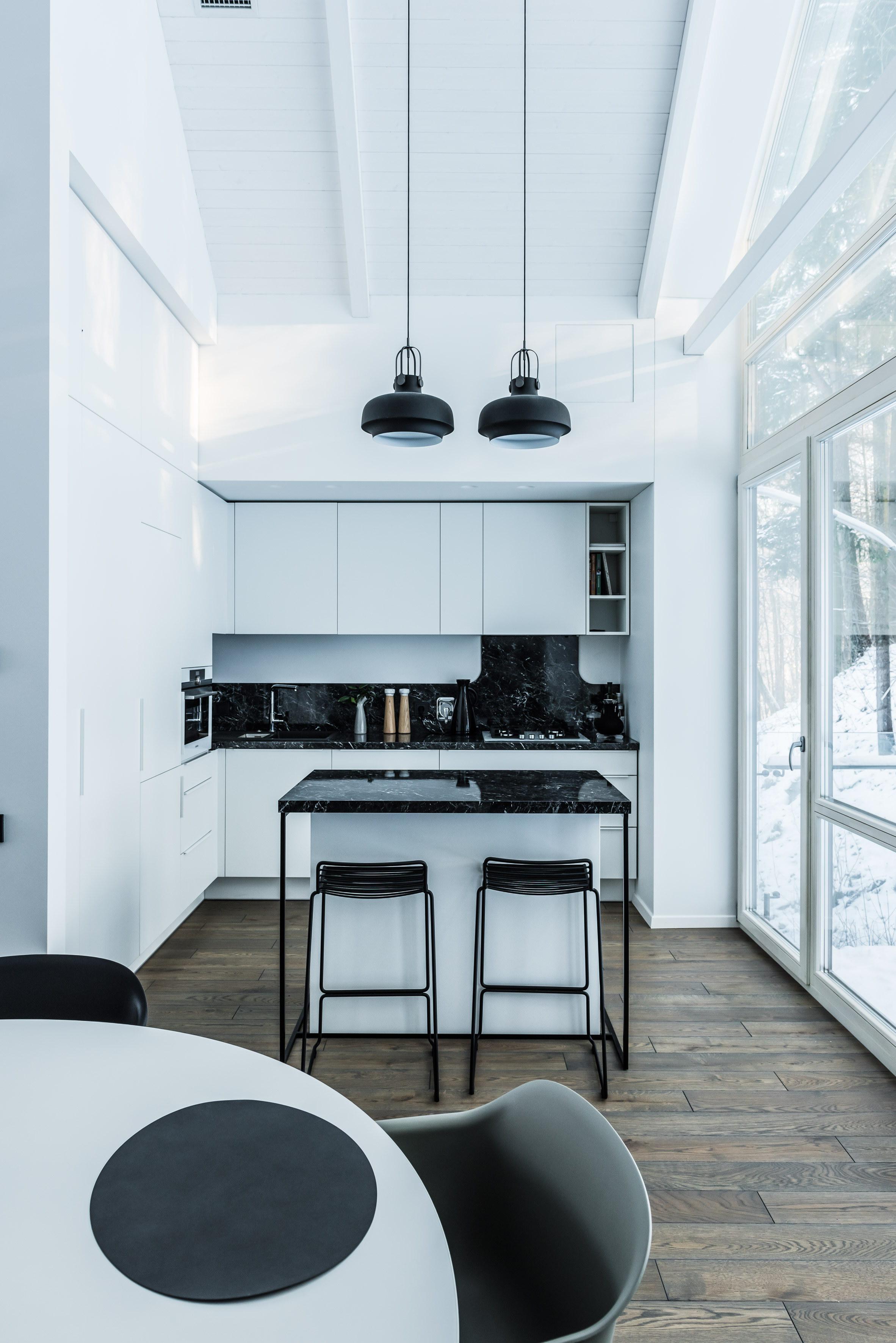 Monochrome Interior of House on Stilts by Dizaino Virtuvė