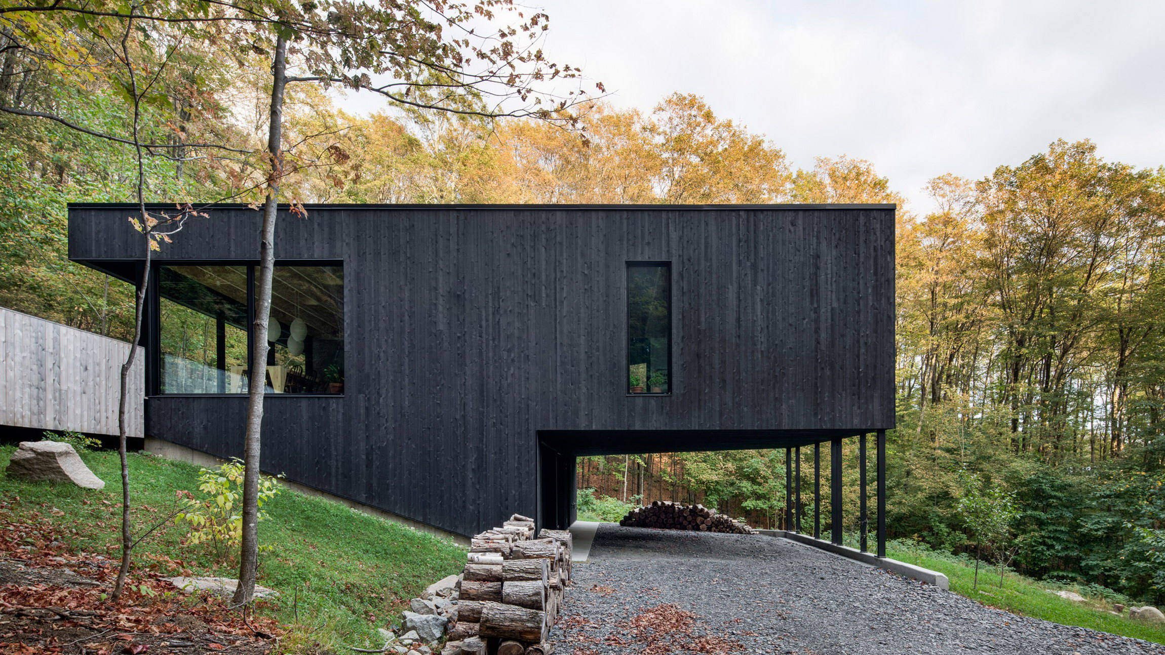 The Rock | Black Residence on a Hillside by Atelier General Architecture
