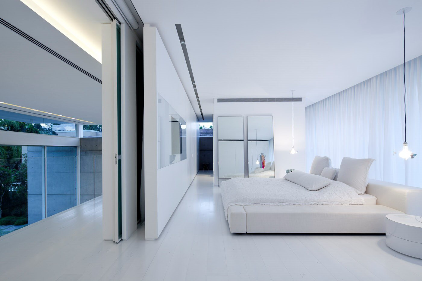 House with Two Courtyards by Pitsou Kedem Architects