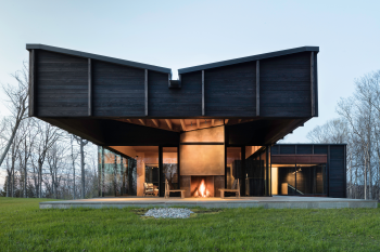 Michigan Lake House Clad in Blackened Wood