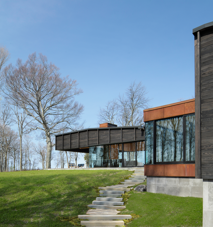 Michigan Lake House Clad in Blackened Wood