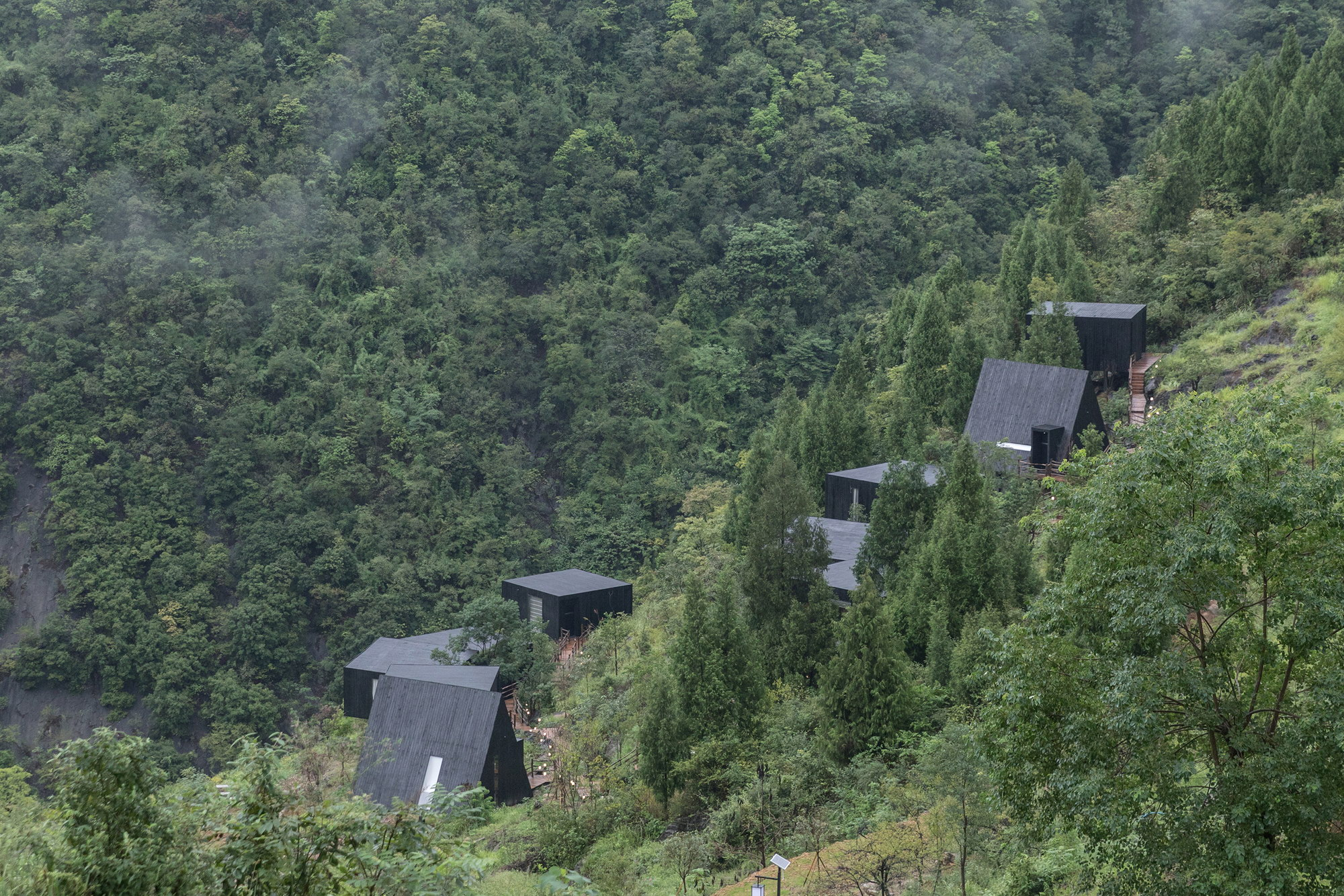 Woodhouse Hotel – Charred Timber Cabins by ZJJZ