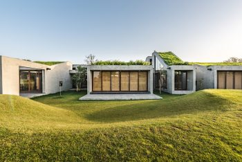 Outhouse with Green Roofs by Misa Architects