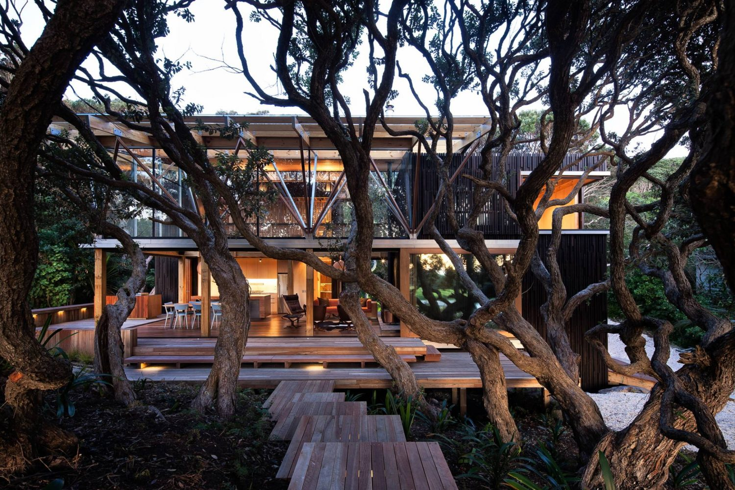 Under Pohutukawa Beach House by Herbst Architects