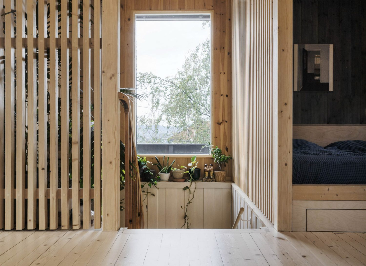 Wood Slat Shotgun House by Austigard Architects