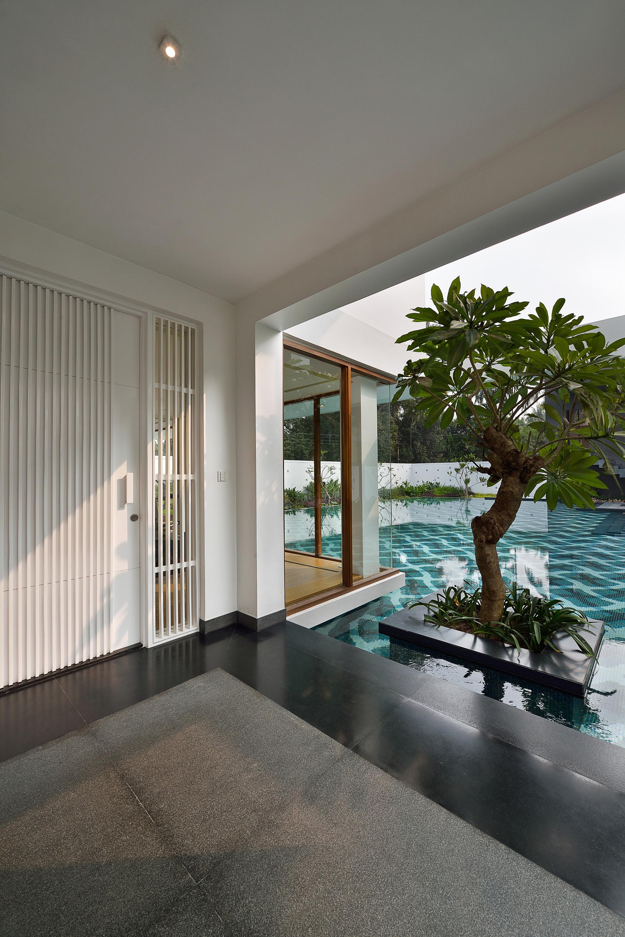 Pool House by Abin Design Studio