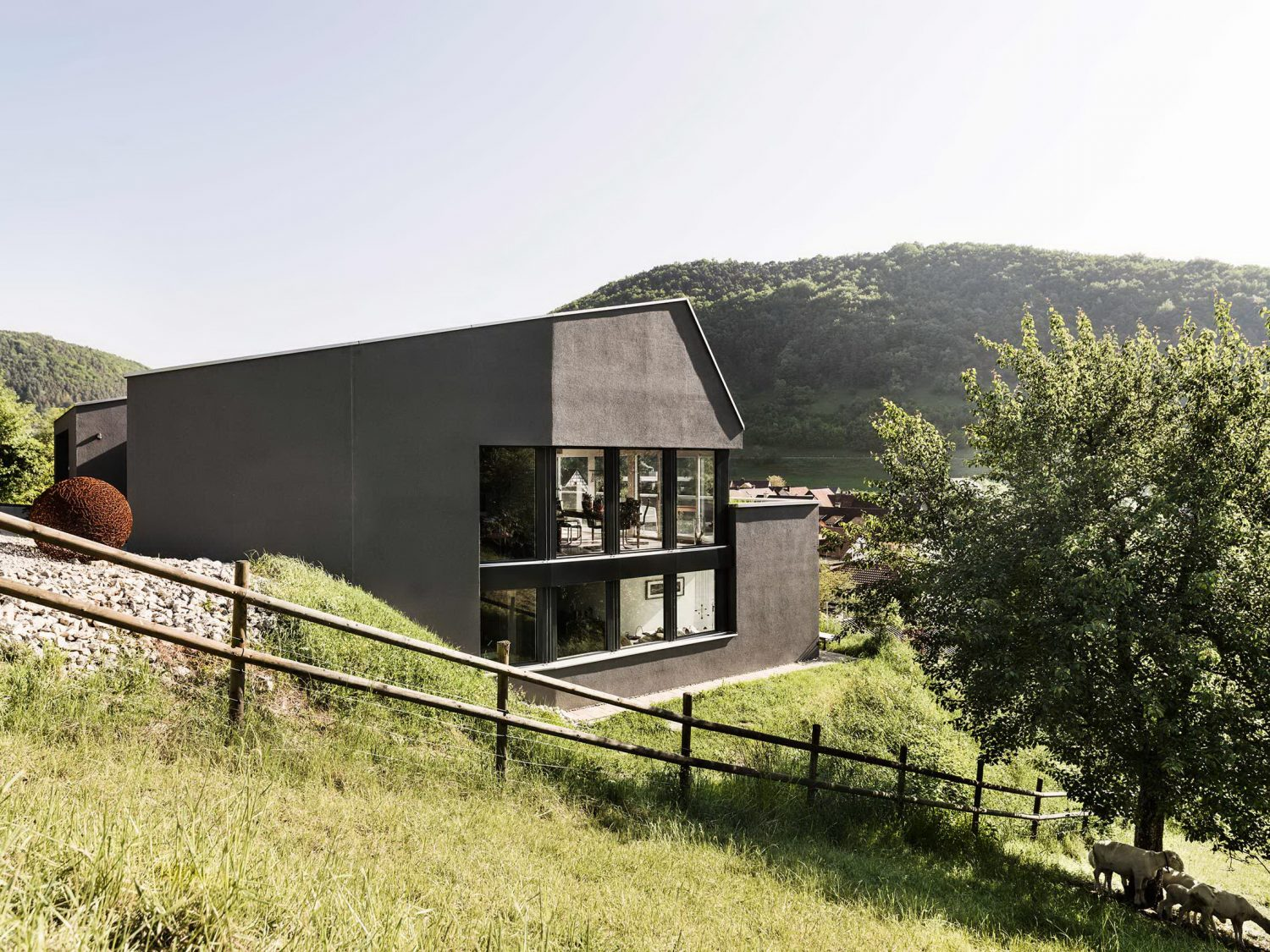 Single Family House on a Slope by Dost
