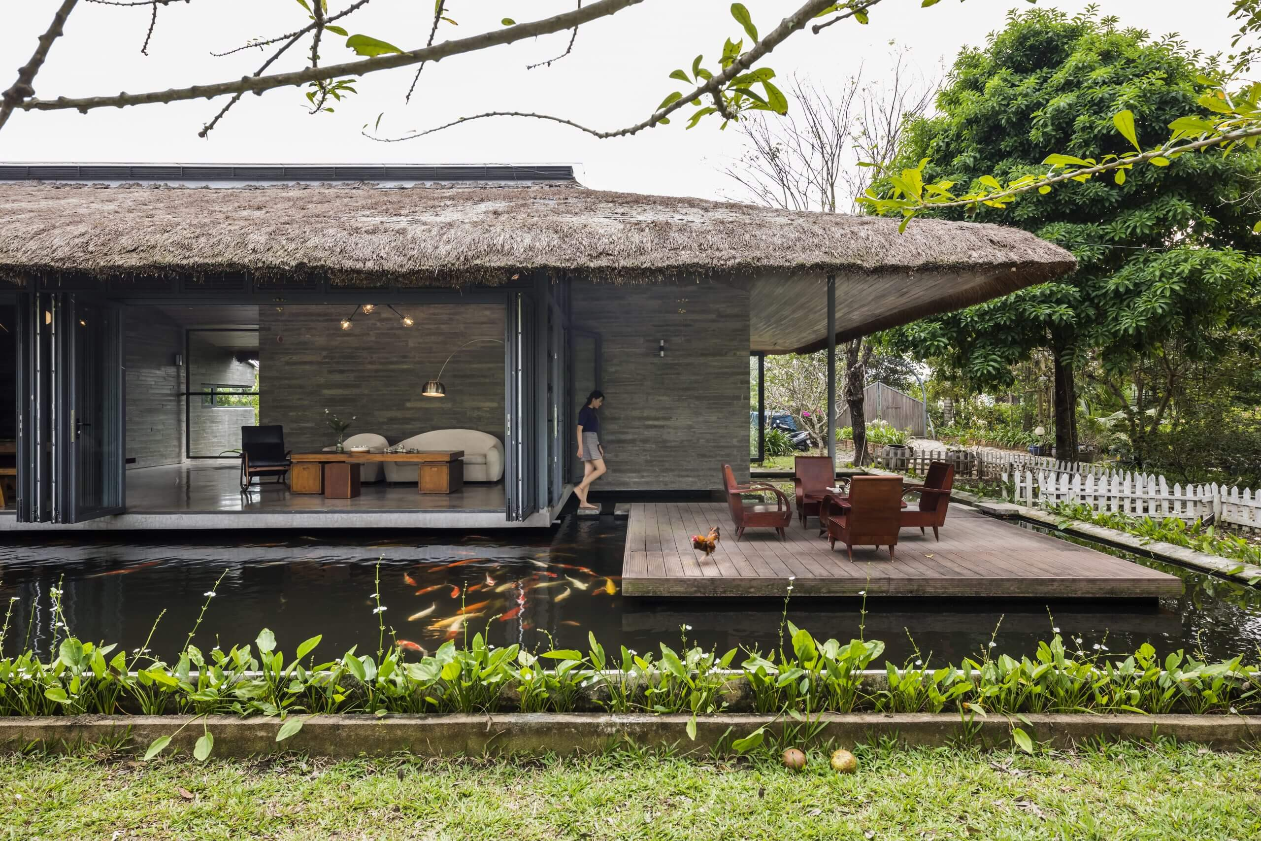 Am House | Garden House with Thatched Roof in Vietnam